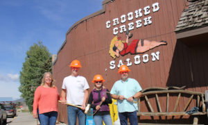 Dawn, Cody, Toni and Fraser Mayor with gold chisels and sledge hammers.