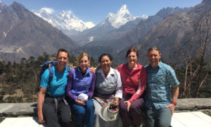 Photo caption 4051: Roger and Michele Hedlund, Tashi Sherpa, Jean and Jamie Wolter in April 2017 with Mt. Amadablam from Tashi's lodge