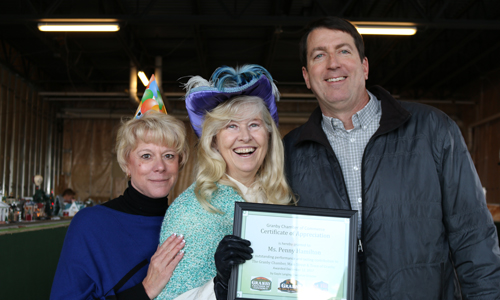 Photo Granby Chamber award: Celebrating the founding of the town of Granby, Penny Hamilton (center) is awarded a Certificate of Appreciation by Gayle Langley and Frank Delay, representing the Town of Granby, Greater Granby Area Chamber of Commerce, and Historic Downtown Granby, in December 2016. (Courtesy photograph)