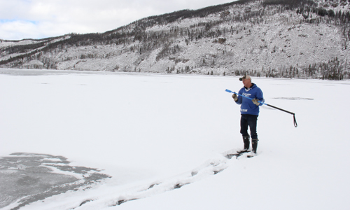 Bernie Keefe checking the condition of the ice on Lake Granby