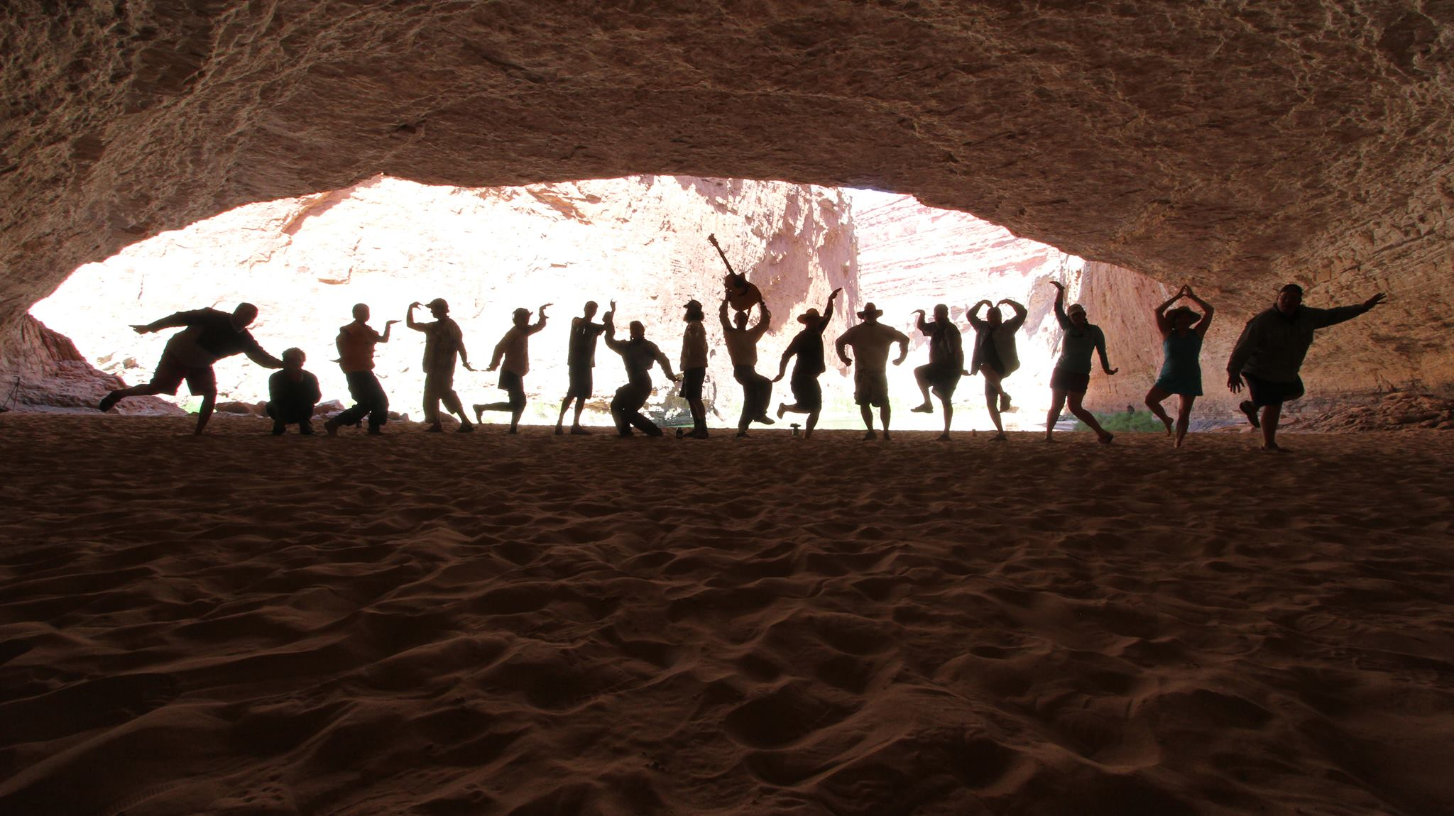 Rafters pose for silhouette shot in Redwall Cavern, Grand Canyon National Park. Photo Courtesy of Michael Turner