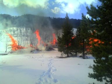 BLM slash pile burns in progress
